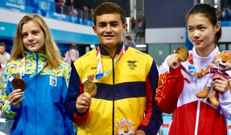 Daniel Restrepo y la china Shan Lin, oro en clavados mixtos
